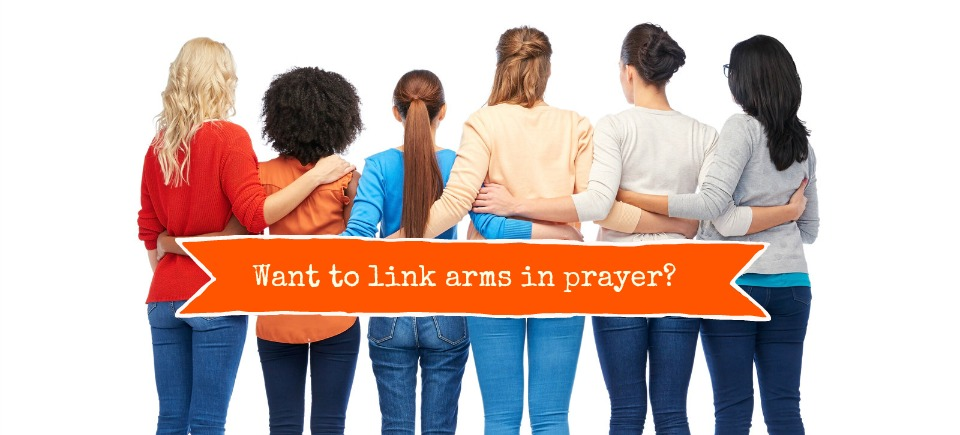 Linking arms in prayer